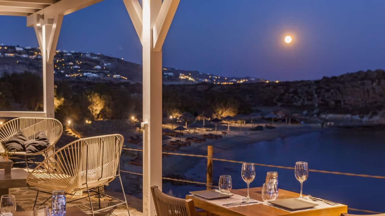 Casa del Mar Mykonos dining by moonlight overlooking the beach