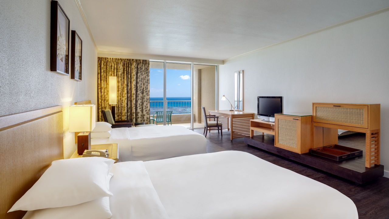 Room with two twin beds and club access