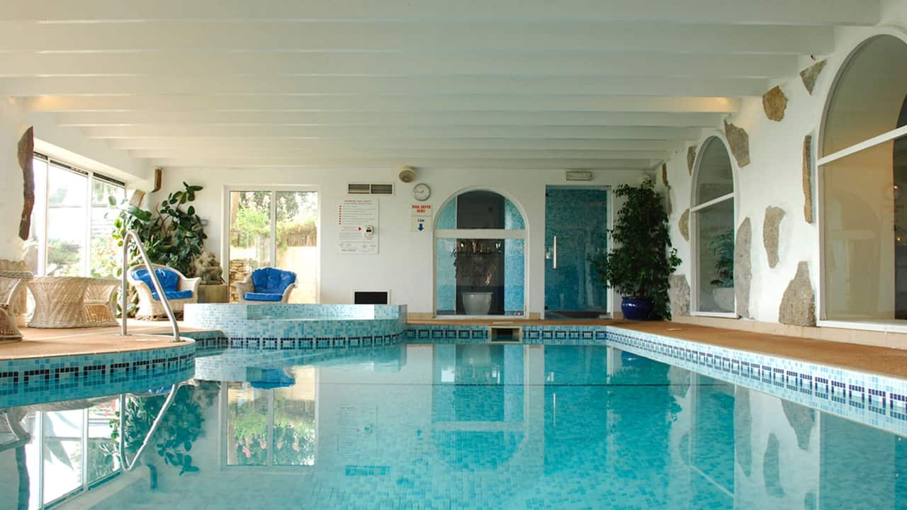 Warm indoor pool with gym, sauna and steam room
