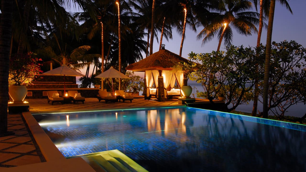 Night time image of the  infinity pool