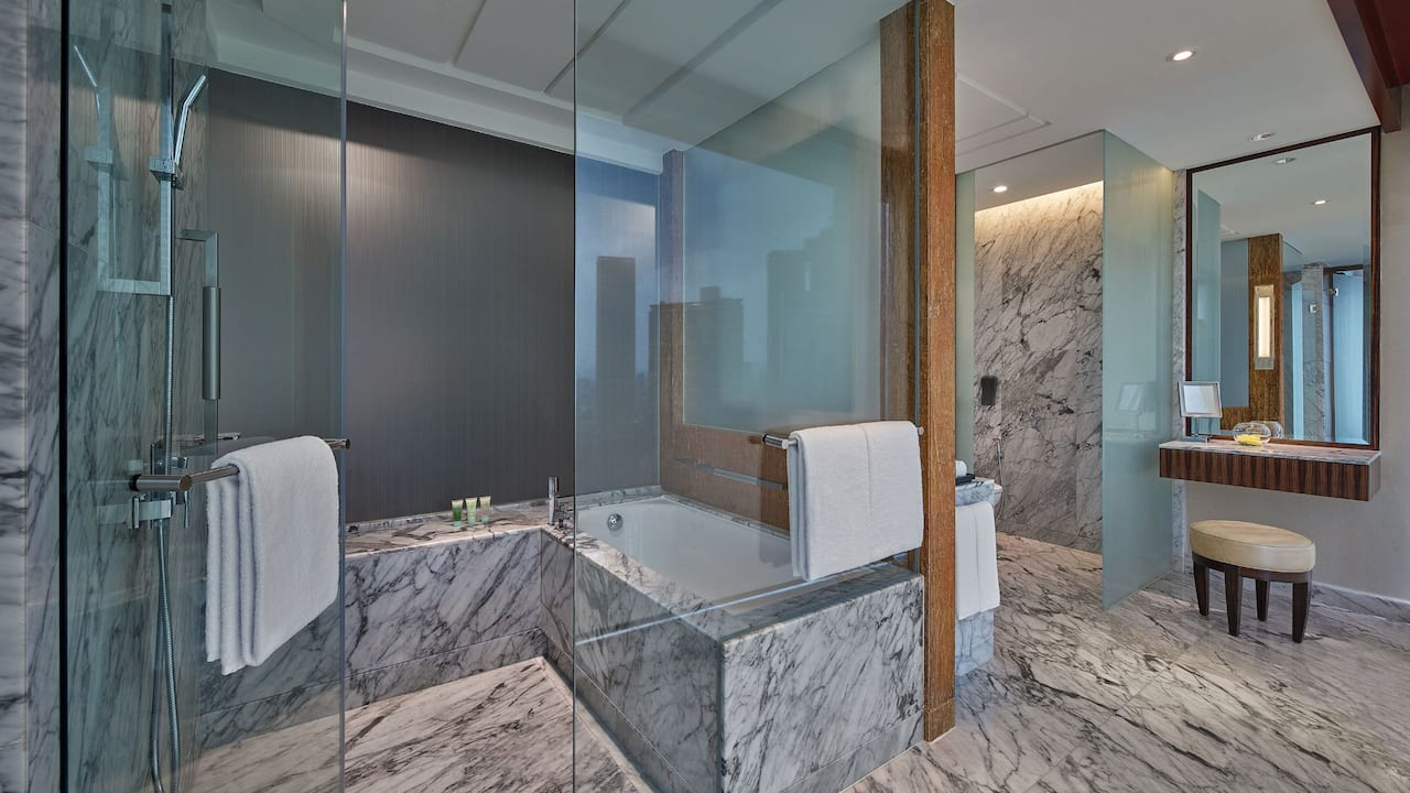 King Deluxe bathroom (bathtub and rainfall shower) at Grand Hyatt Kuala Lumpur