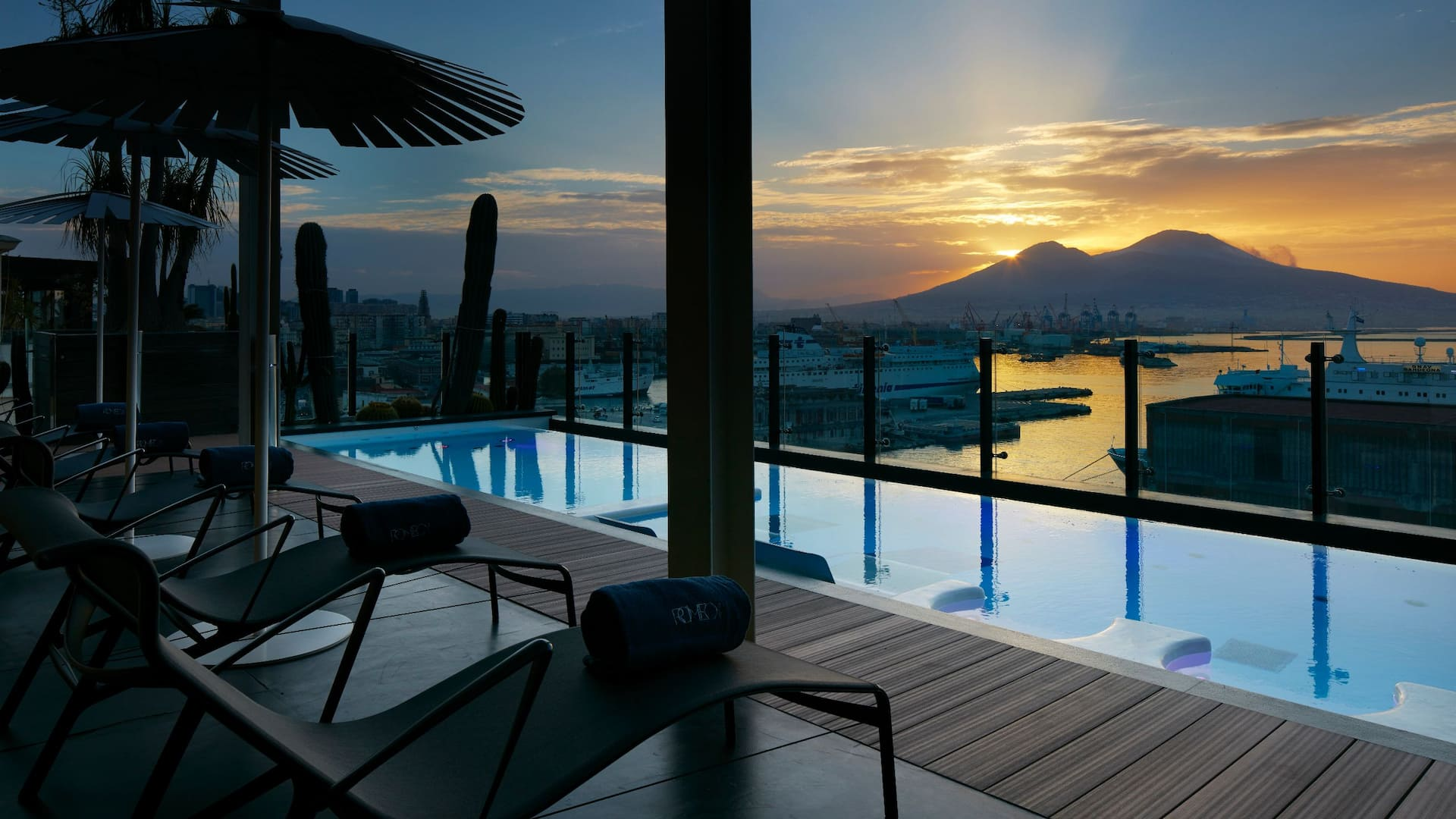 Hotel pool with mountain sunset view