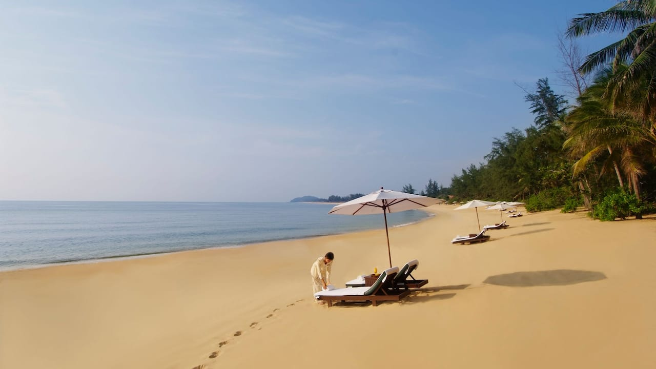 Tanjong Jara remote beach with lounge chairs and umbrellas