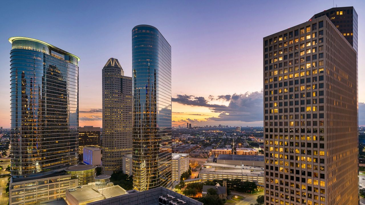 A view of the Hyatt Regency Houston and downtown Houston at night