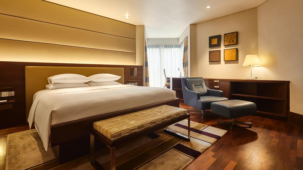 Stylish One Bedroom Premier Suite with king-size bed at Grand Hyatt Singapore