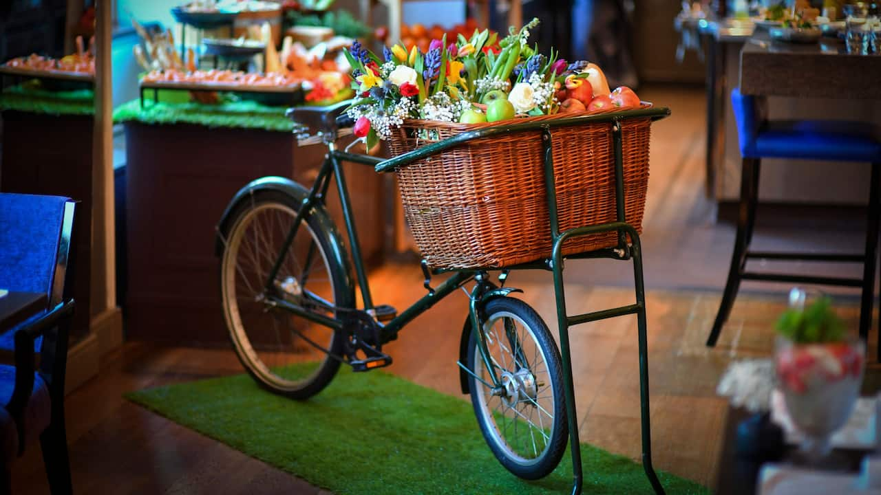 Sunday Garden Brunch at The Montagu Kitchen with bicycle and flower decoration
