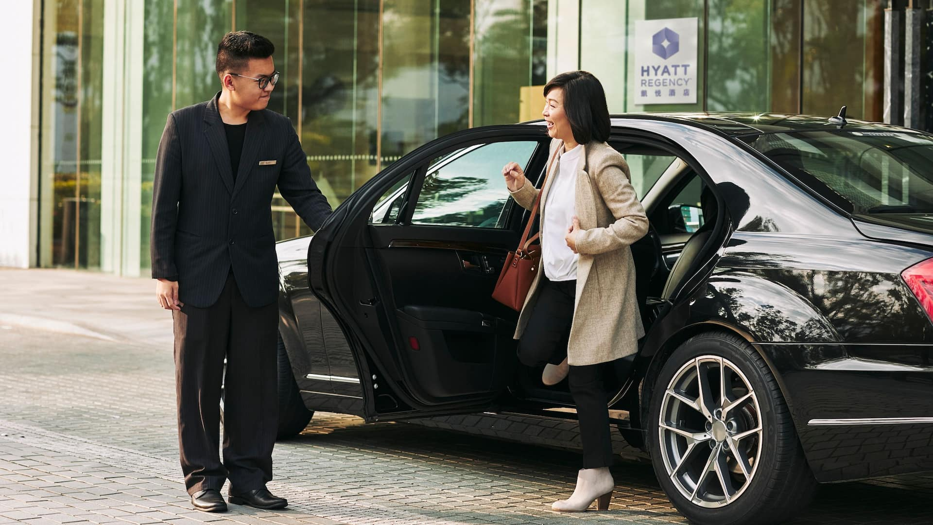 Business woman exiting car driveway