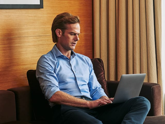 Andaz Business Traveler Man Working Laptop Couch