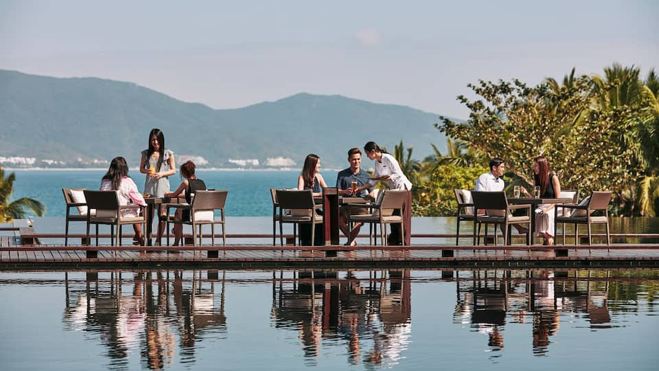 Guests dining lakeside