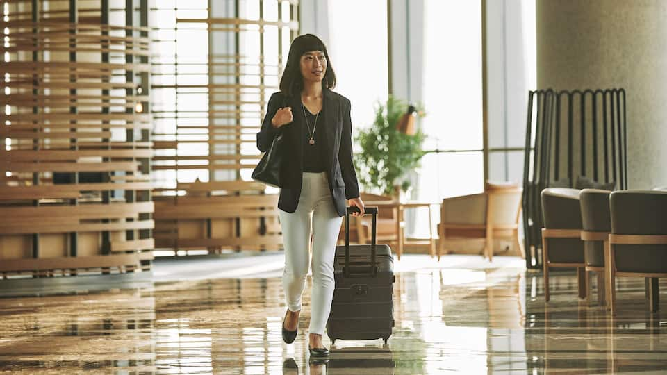 Business Woman Traveling through Lobby