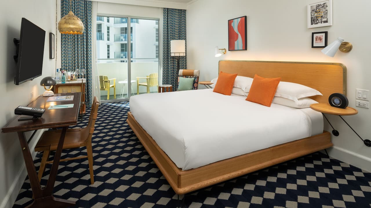 hotel room with a king bed and balcony near Miami Beach