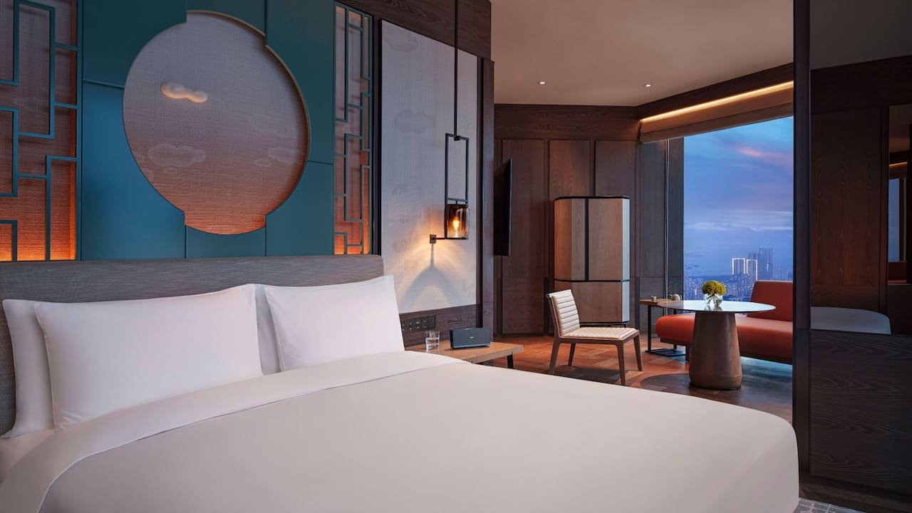 One King Bed with Skyline View