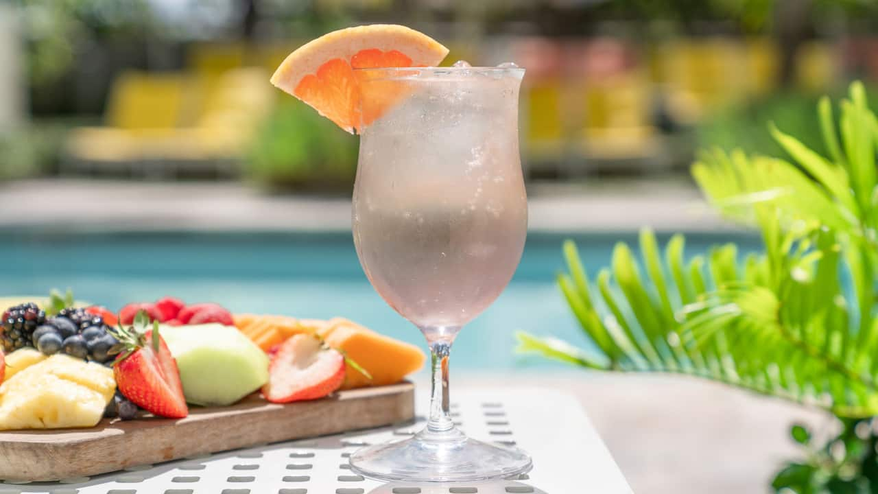 Delight in Refreshing Cocktails & Bites Poolside
