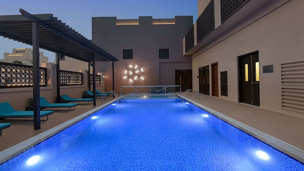 Rooftop swimming pool at night