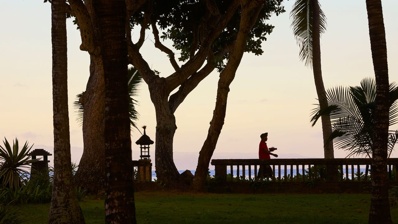 Man Silhouette Walking in Sanur Beach Pathway