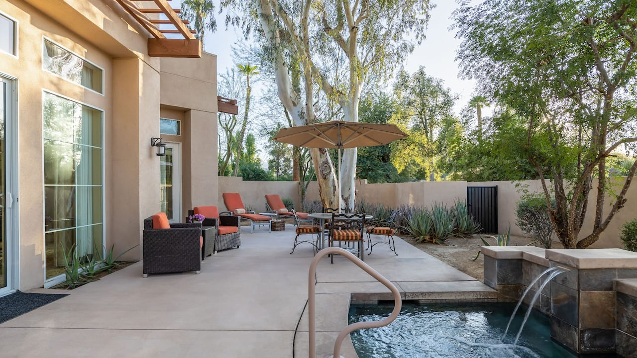 A spacious villa patio with a small pool and patio seating at Hyatt Regency Indian Wells Resort & Spa