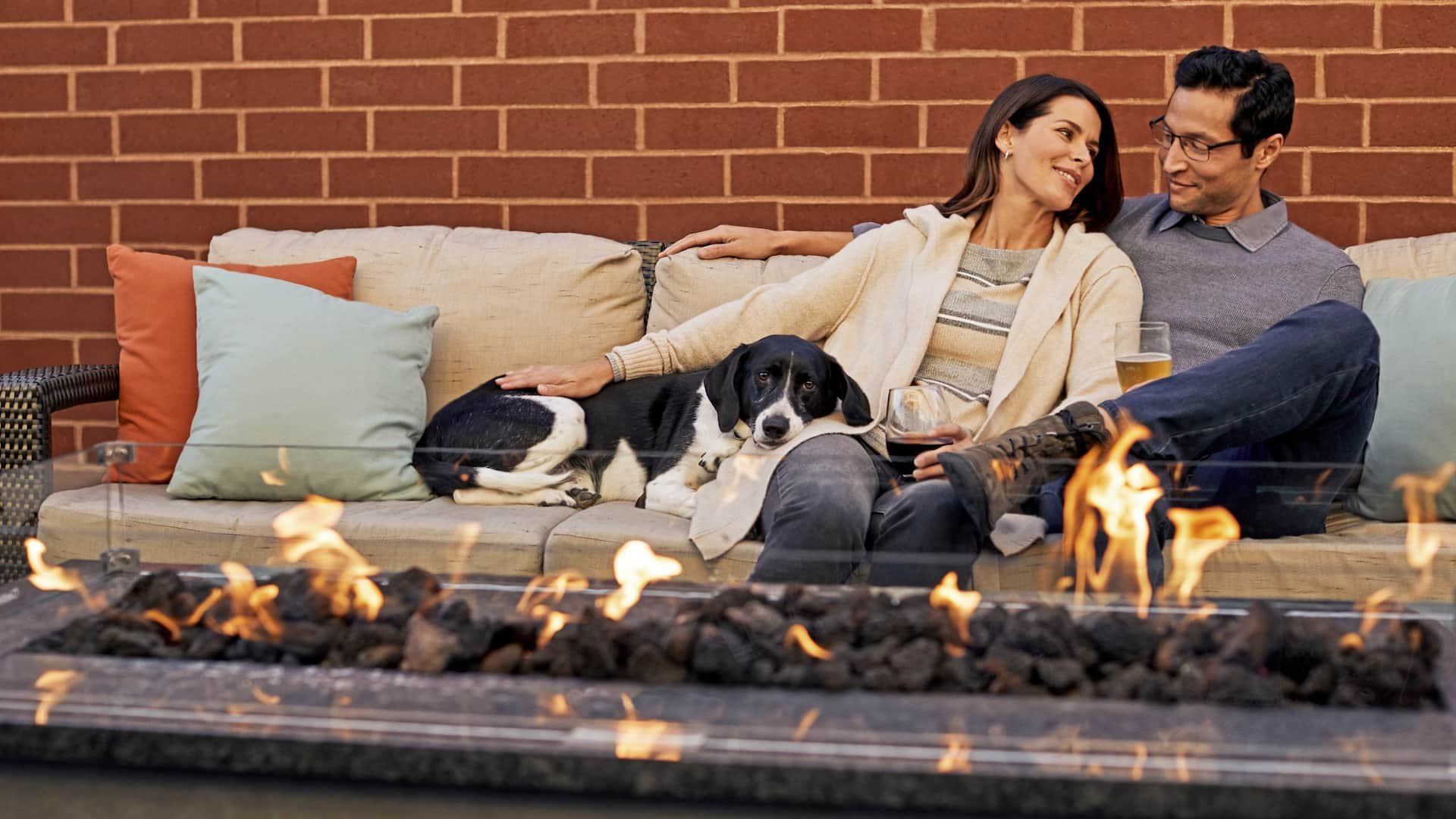 Patio Fireplace Couple with Dog