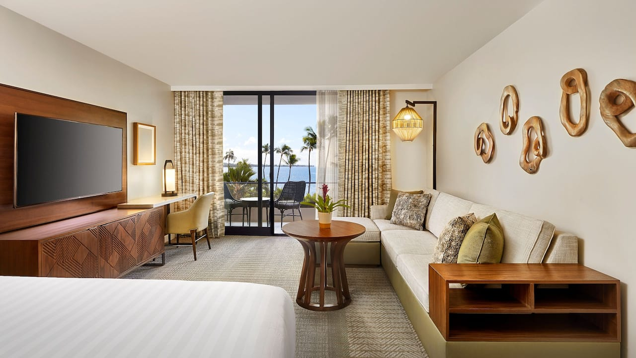 Hotel room with an ocean view and king bed at Hyatt Regency Maui