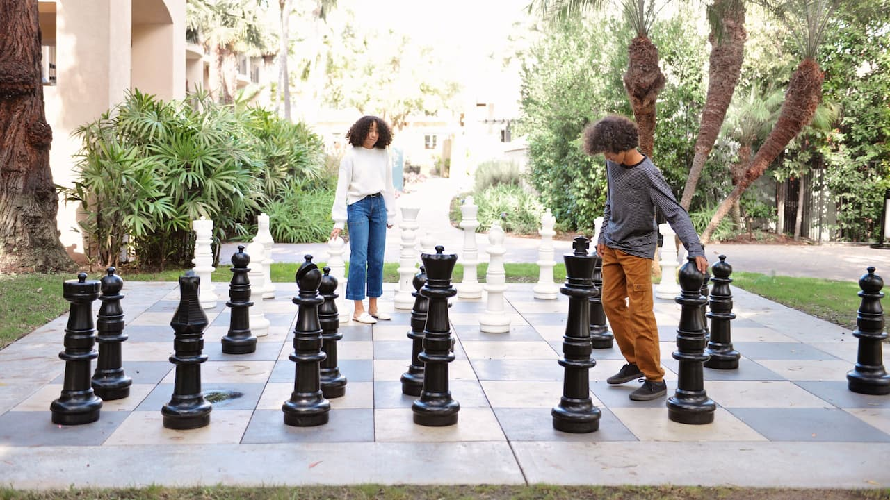 Children Playing Giant Chess
