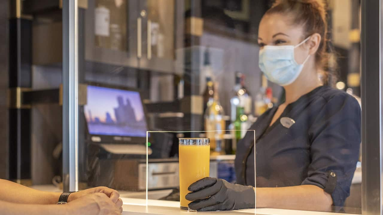 Hotel Portland Maine Staff Serving Cocktail Wearing PPE