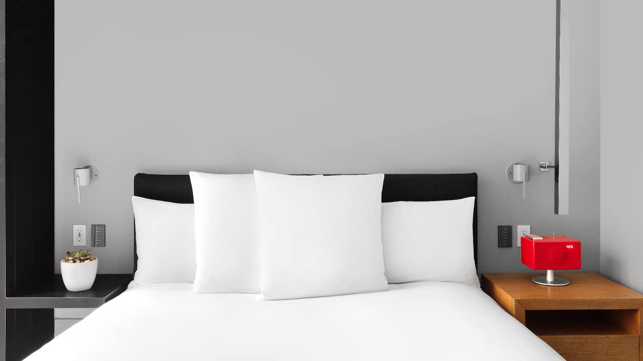 Hotel room with king bed at a luxury Midtown Manhattan hotel