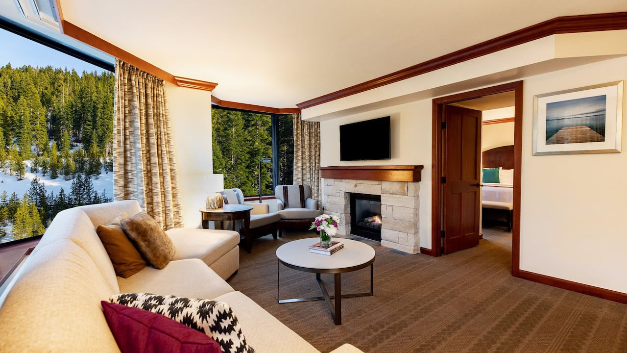 Deluxe Fireplace Suite Forest View Living Area and Bedroom