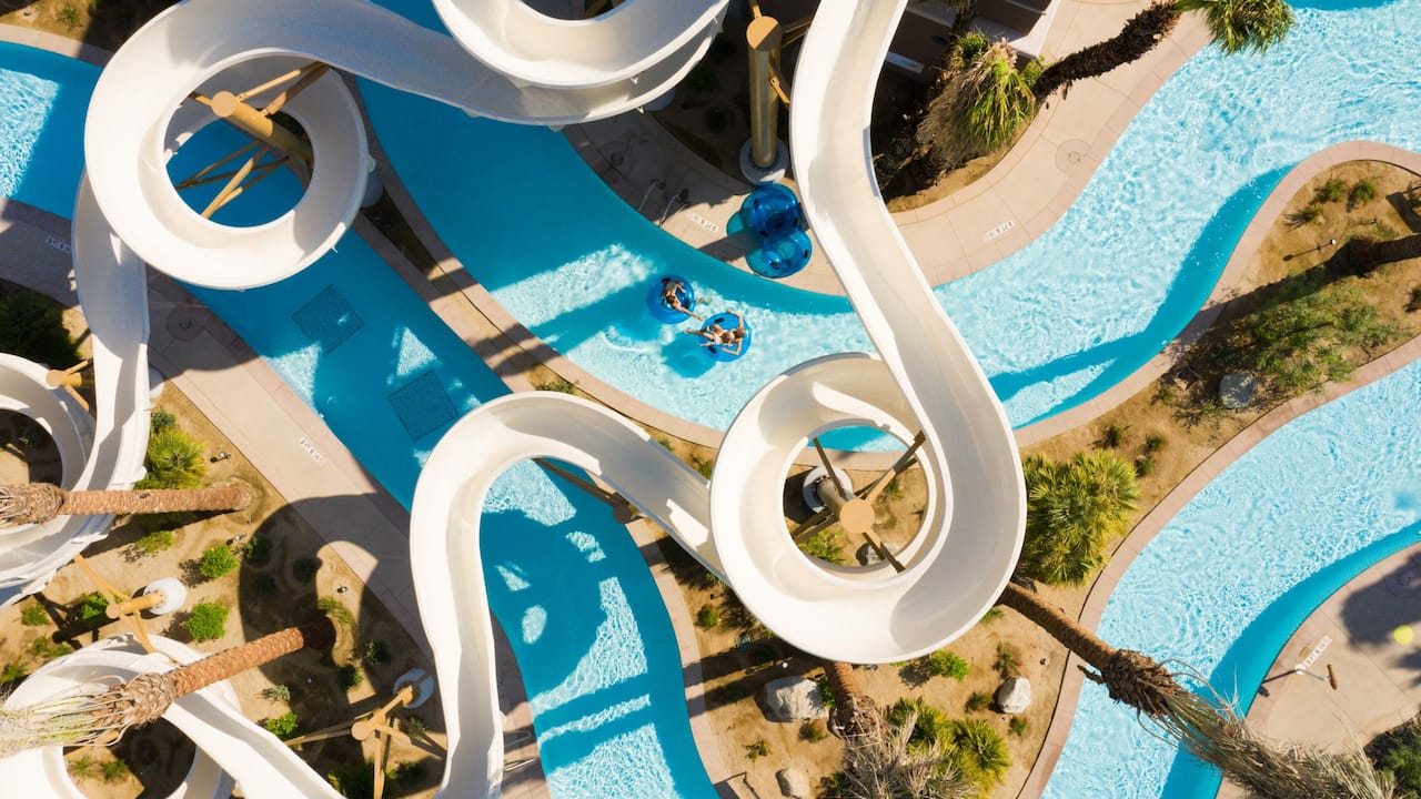 An aerial view of the resort's waterpark overlooking the waterslides and the lazy river located in Palm Springs