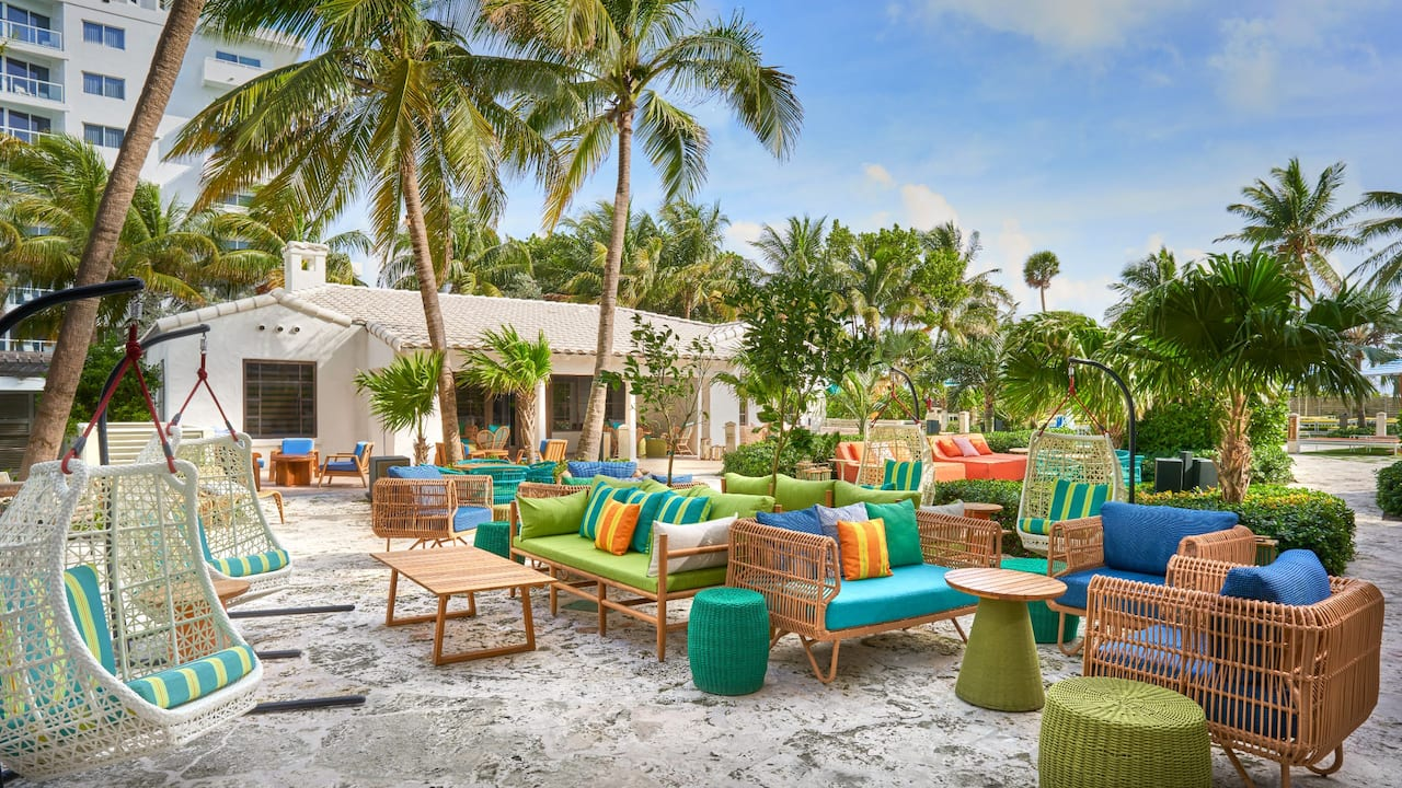 outdoor lounge area at The Confidante Miami Beach
