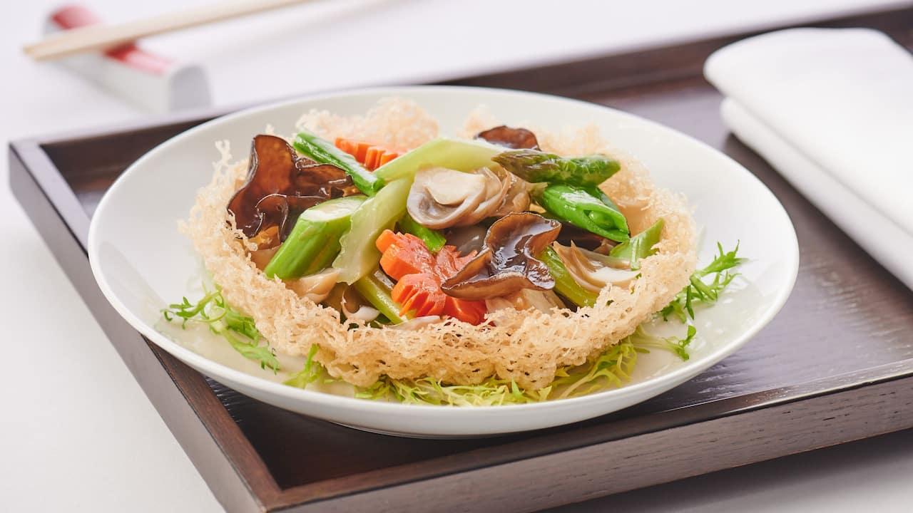 Stir-fried vegetables on basket