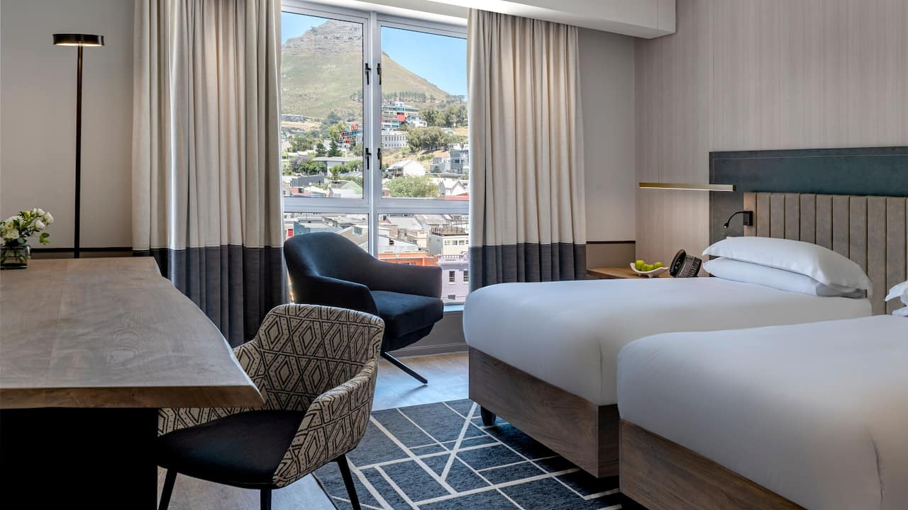 Twin Bed with Table Mountain View