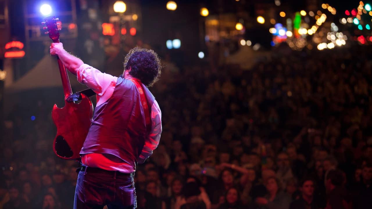 Guitarist performing live at a concert