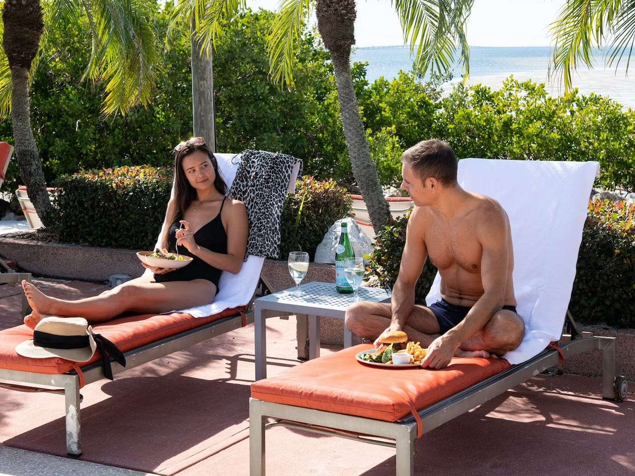Bayside Pool Couple Sitting Meals