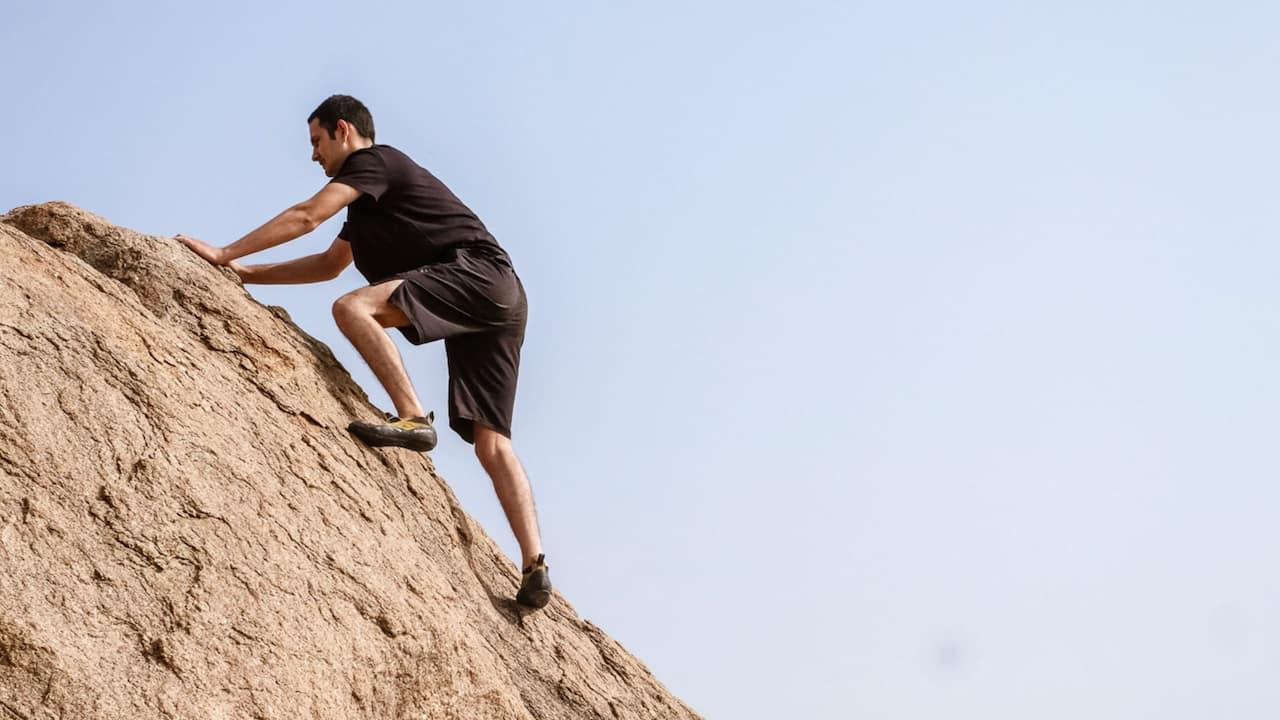 Man Boulder Climbing