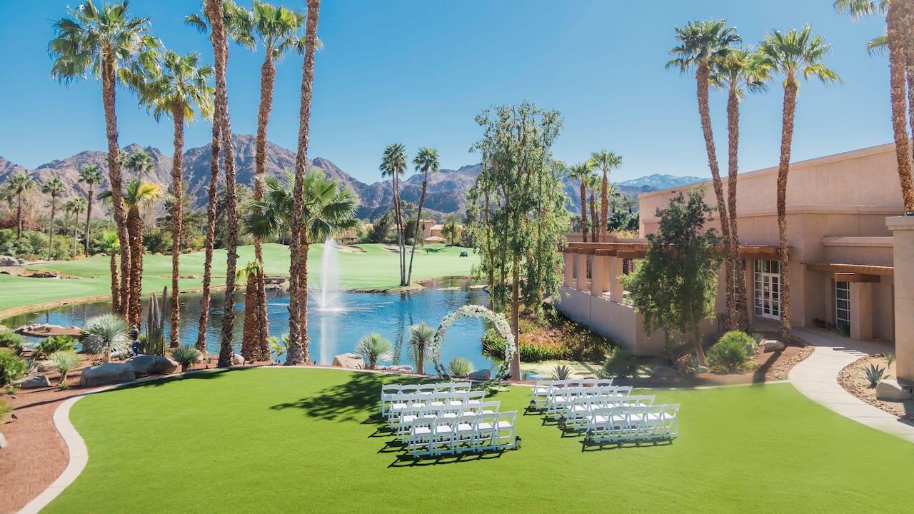 A dimly lit outdoor wedding ceremony in Indian Wells at Hyatt Regency Indian Wells Resort & Spa