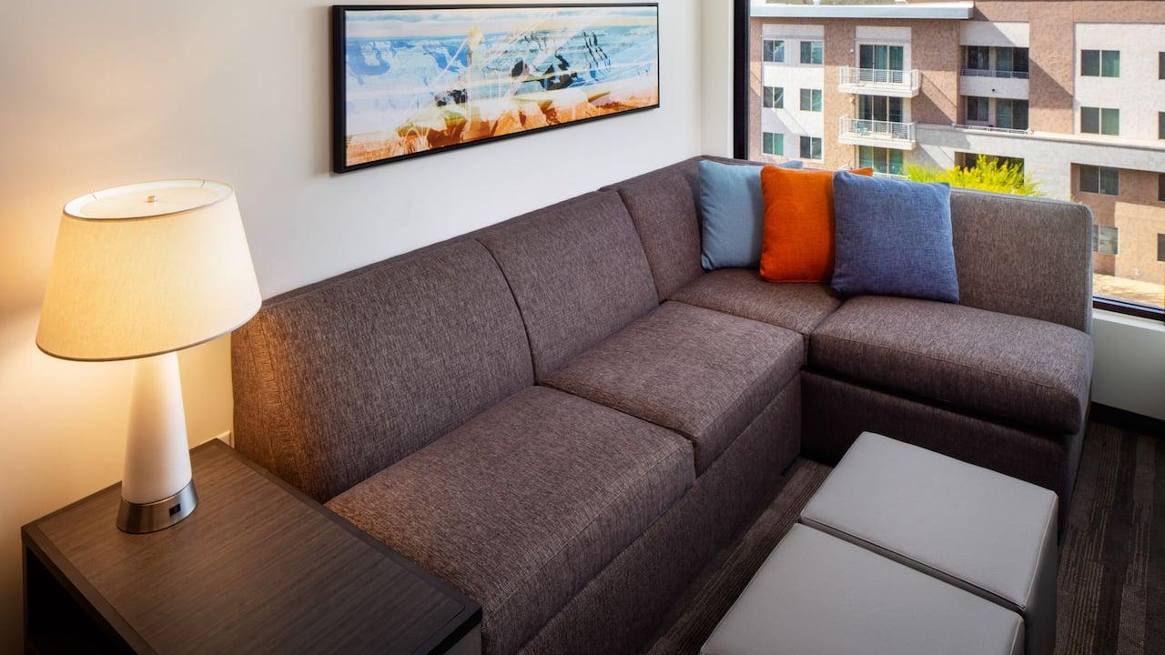 Cozy corner guestroom seating area at Hyatt House North Scottsdale