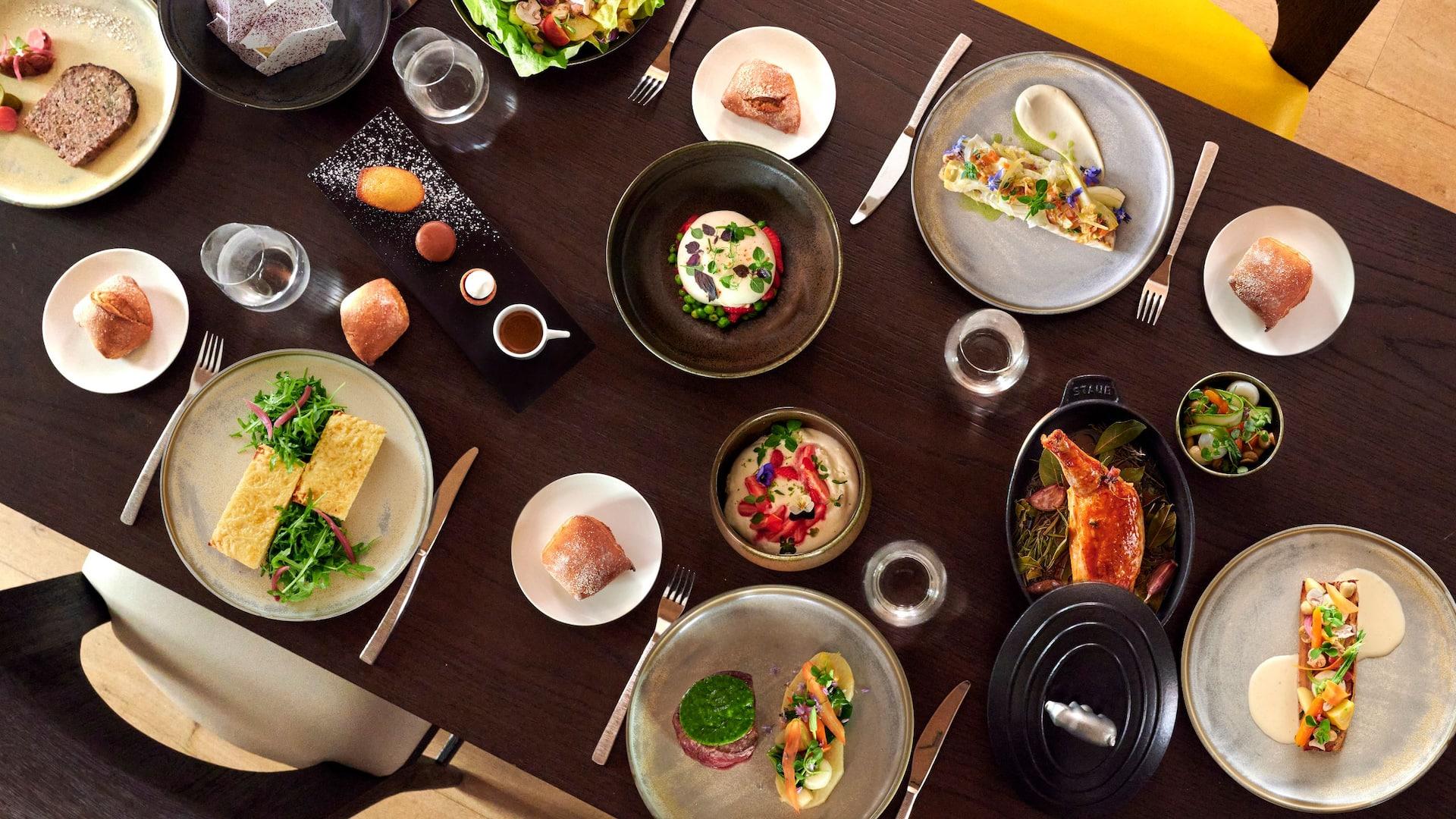 Table with gourmet food at Hyatt Paris Madeleine