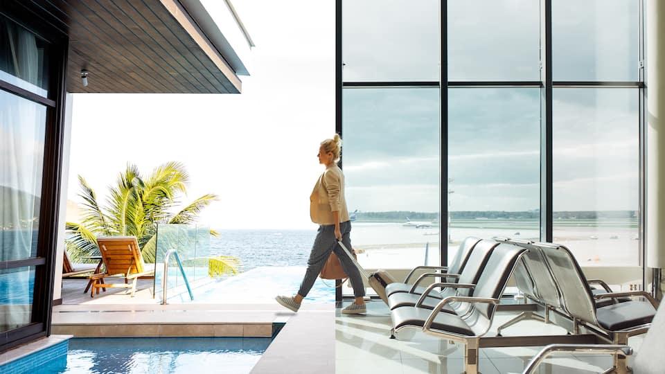 Woman at airport and pool