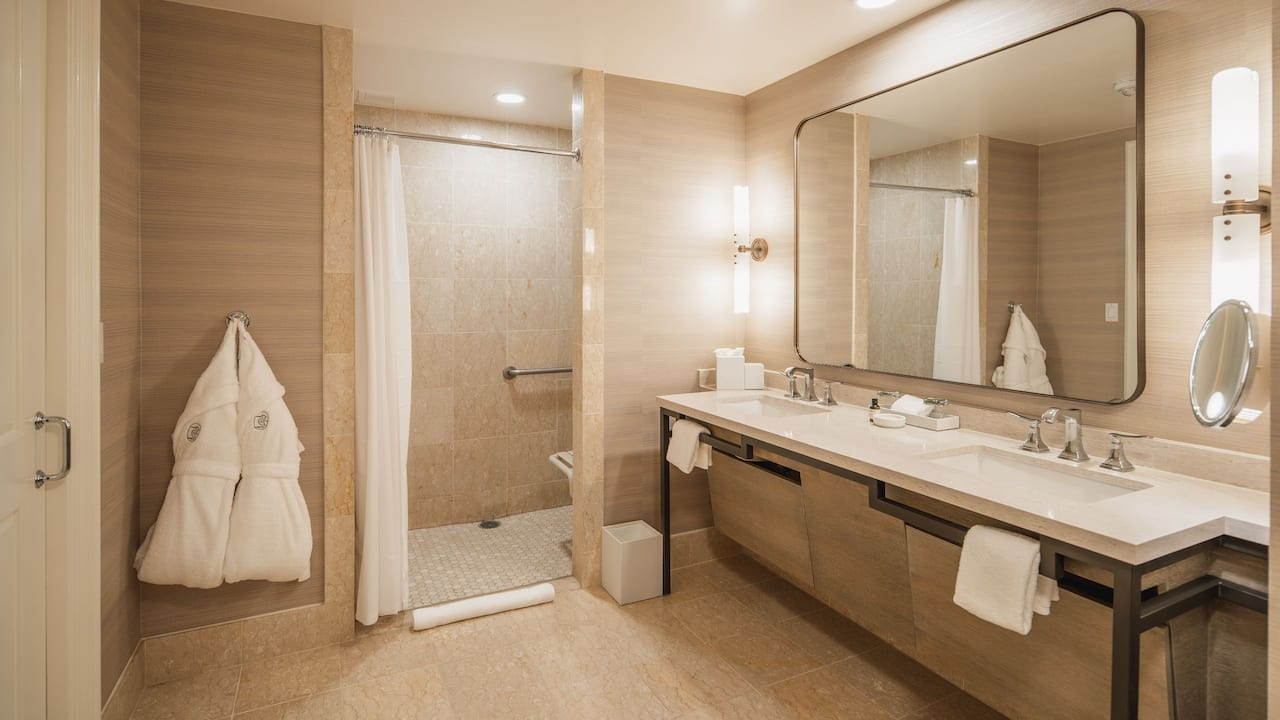 One king bedroom with a spacious balcony and a ADA compliant shower
